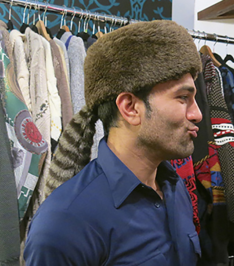 Rez models faux coonskin cap