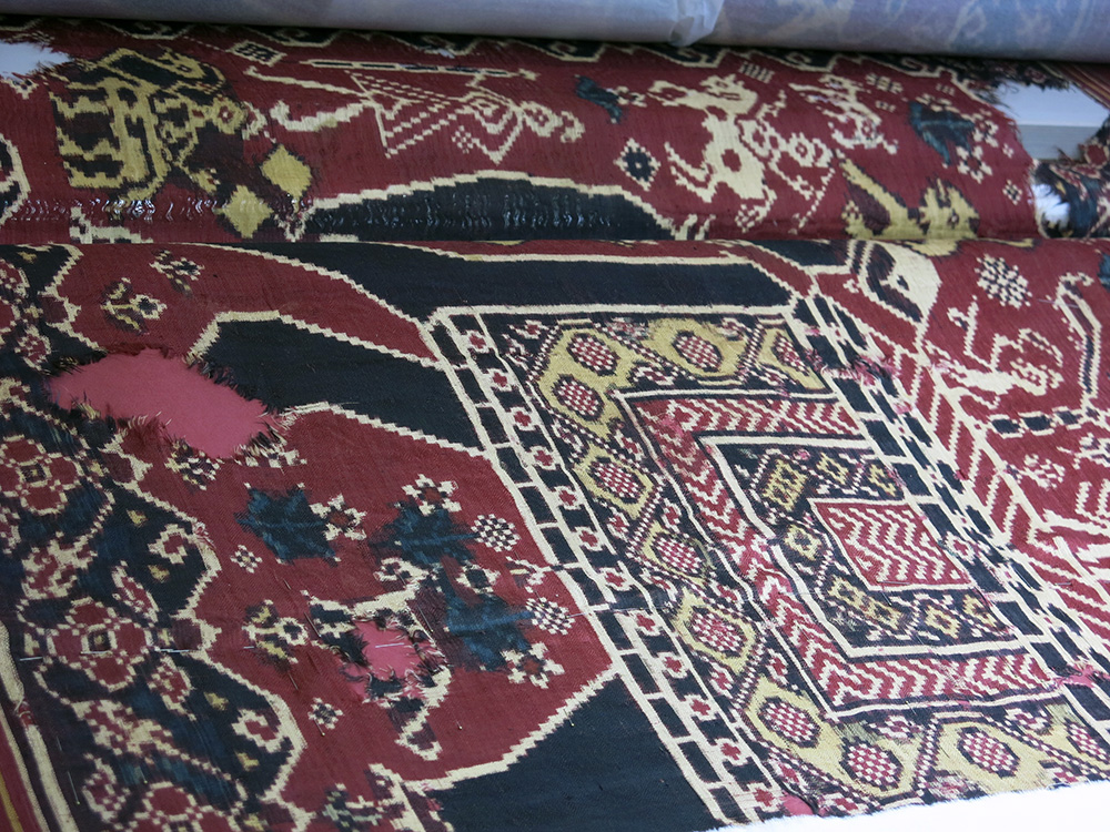 Close up of damage to double ikat silk