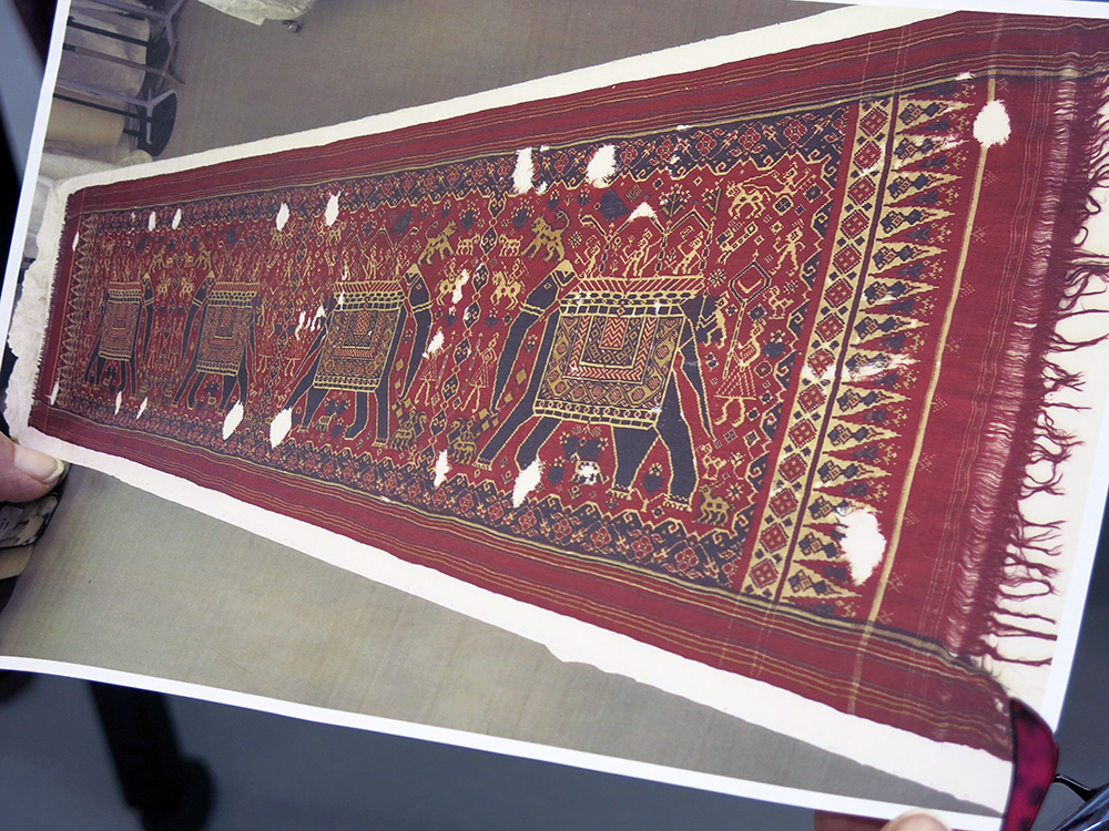 Photograph of double ikat with damage