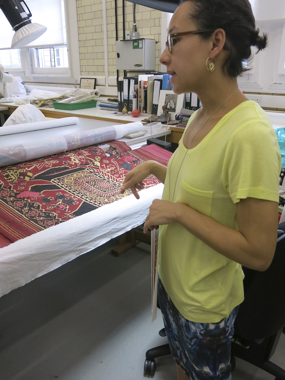 V and A conservator works on double ikat design