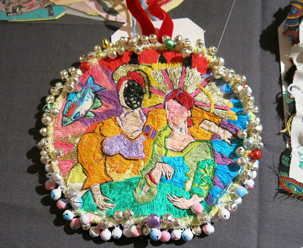 Embroidered pendant by Sophie New